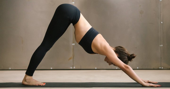 A Simple Sleep Yoga Sequence To Prepare Your Body For Shut-Eye