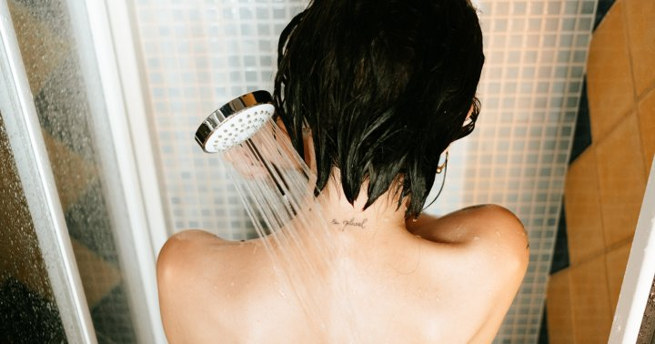 Is It Bad To Wash Your Face In The Shower? We Dive Into The Debate