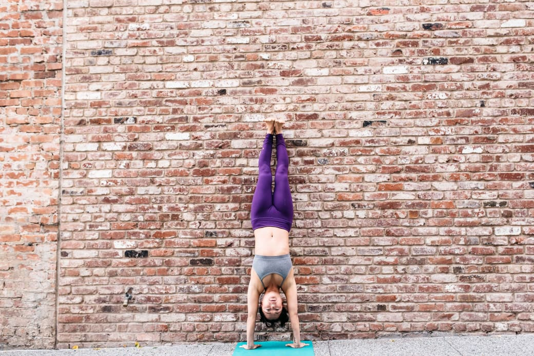 handstand or dolphin yoga pose