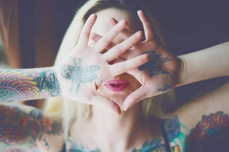 Tattooed guy arousing sexually