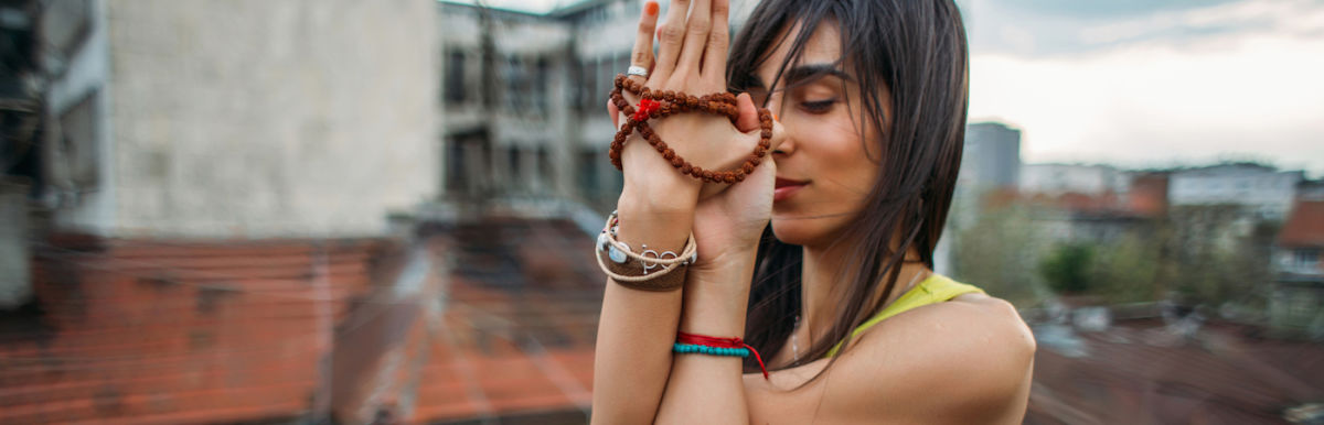 A Breathing Practice To Help Ground Your Root Chakra Hero Image