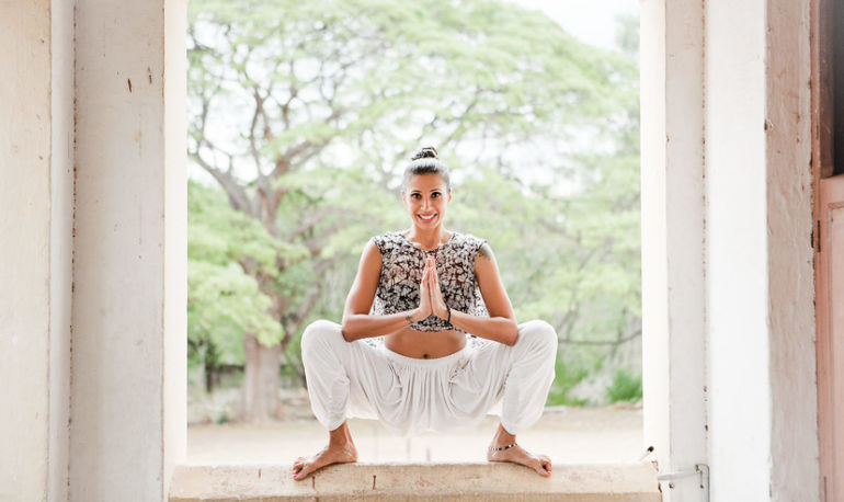 4 Yoga Poses To Keep Your Gut On Track While You Travel Hero Image