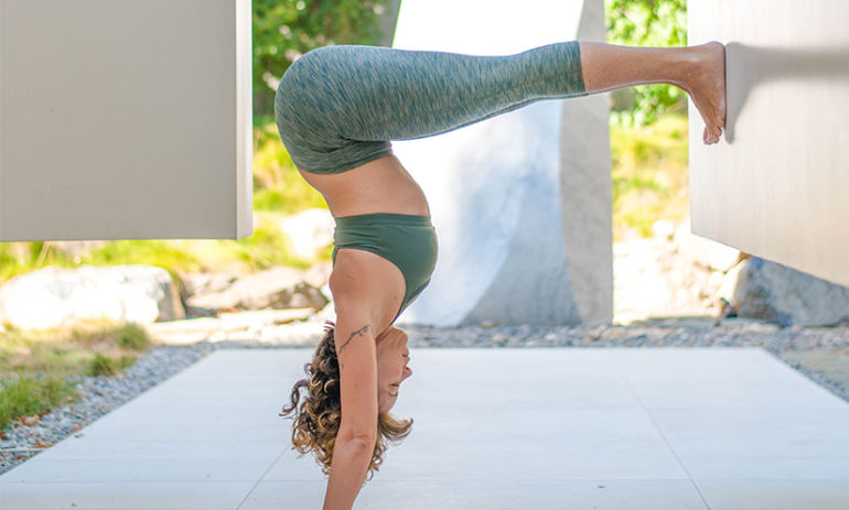 7 Invigorating Yoga Poses to Sweat Your Asana Off Hero Image