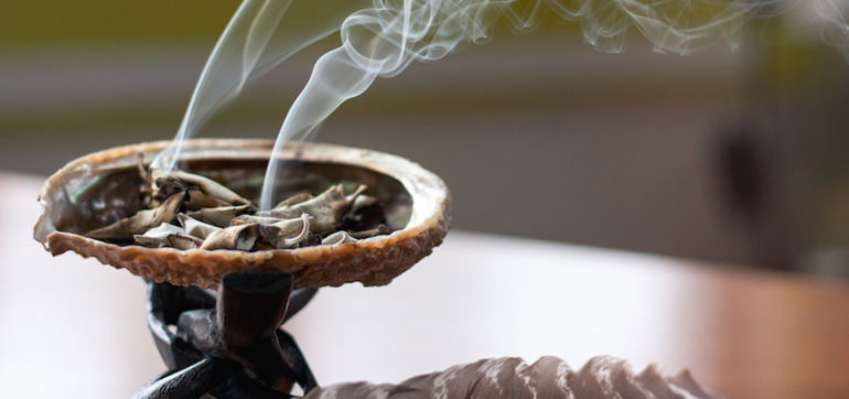A Sage Smudging Ritual To Cleanse Your Aura & Clear Your Space Hero Image