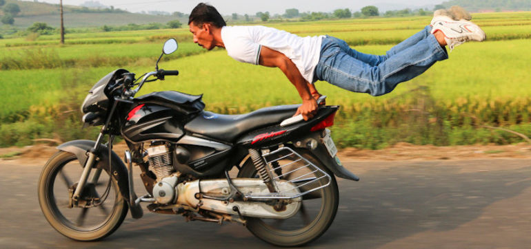 Watch This Badass Yogi Do Asanas On A Speeding Motorcycle Hero Image