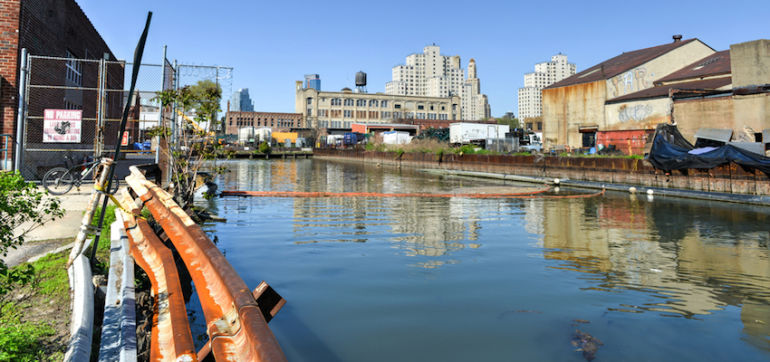 Man Swims Through Poop-Laden Gowanus Canal To Honor Earth Day Hero Image