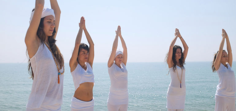 Kundalini Yoga: Why It Has The Power To Heal + Isn't As Weird As You May Think Hero Image