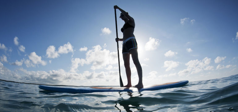 A 15-Minute Yoga Sequence To Warm Up For SUP & Surfing Hero Image