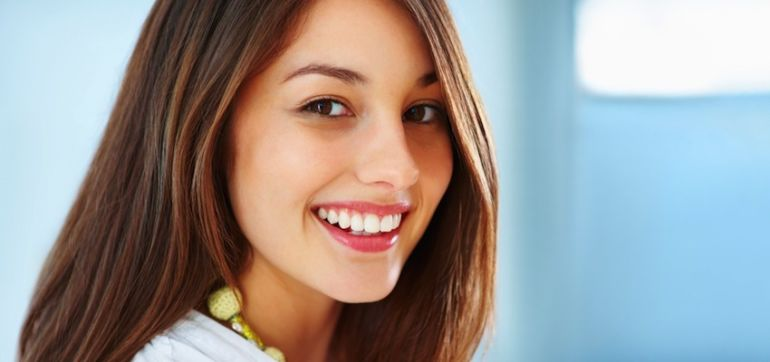 What Your Dentist Won't Tell You: 6 Natural Steps To A Gorgeous Smile Hero Image