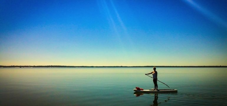 Love Yoga? Give Stand-Up Paddleboarding A Try! Hero Image