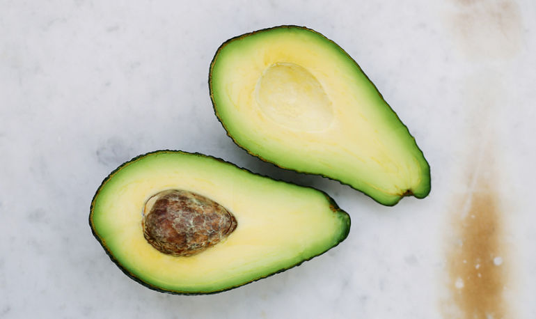 Why You Need To Stop Throwing Away Avocado Pits Hero Image