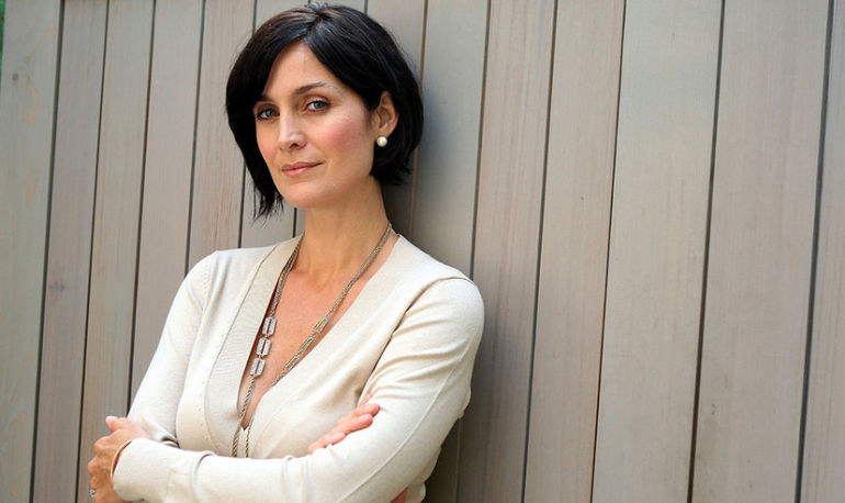 Carrie-Anne Moss On Yoga, Passion, And #Wellth Hero Image