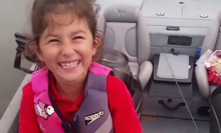 You Have To See What This Little Girl Catches With Her Barbie Fishing Pole Hero Image