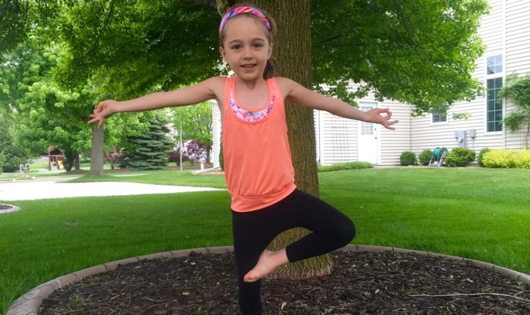 A 5-Minute Energizing Yoga Sequence You Can Do With Your Kid Hero Image
