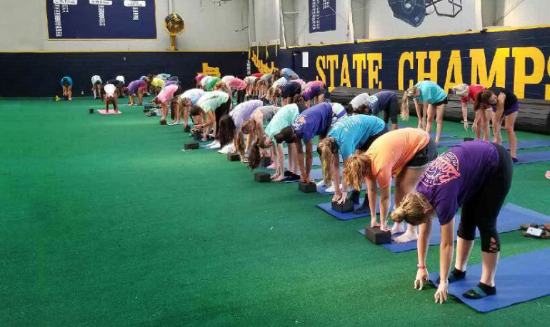 A Football Camp In A Tiny Texas Town Now Offers Yoga. Here's Why Every Single Player Is Doing It Hero Image