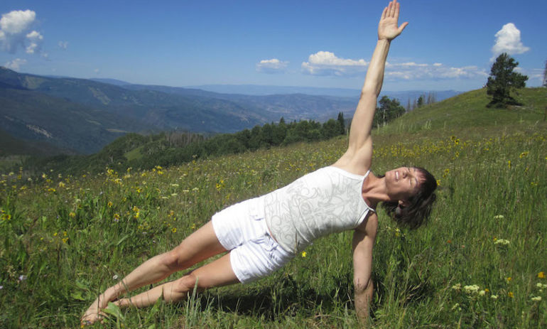 8 Great Yoga Poses To Stretch Your Arms & Shoulders Hero Image
