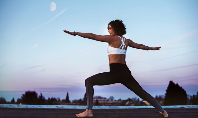 Unleash Any Pent-Up Energy With This Powerful Lunar Yoga Flow Hero Image