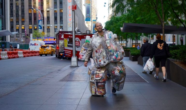 Meet The Man Who's Walking Around NYC Wearing 84 Pounds Of Trash Hero Image