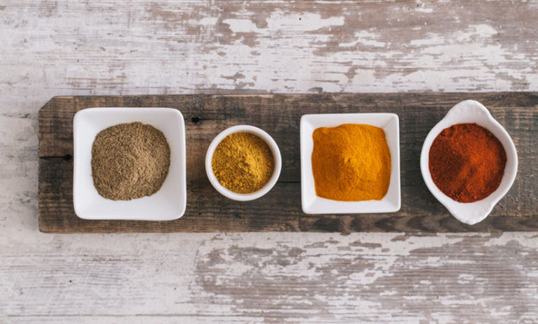 10 Spices & Condiments To Keep In Your Kitchen If You're Trying To Eat Healthy Hero Image