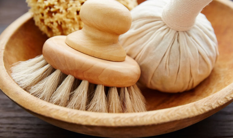 A 5-Step Guide To Dry Brushing Your Face For Brighter Skin Hero Image