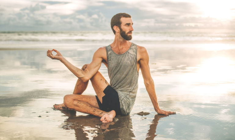 Why Every Man Needs To Incorporate Yoga Into His Workout Routine Hero Image