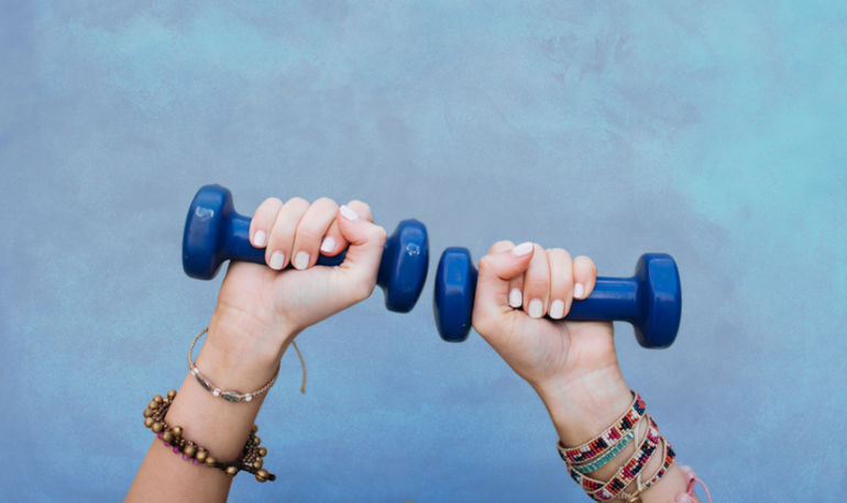 Will Lifting Weights Make You Bulky? A Personal Trainer & Yogi Tells All Hero Image