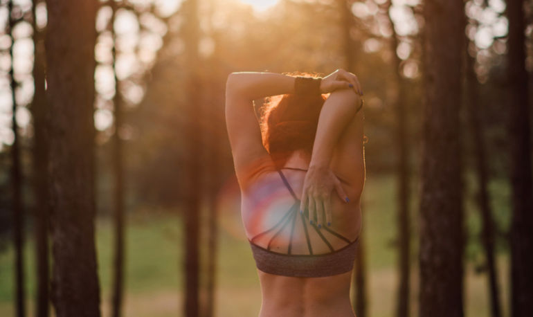 3 Stretches You Should Do Every Day To Keep Your Back Healthy & Pain-Free Hero Image