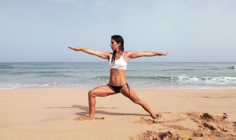 Beach Yoga: Poses To Do Barefoot In The Sand Hero Image