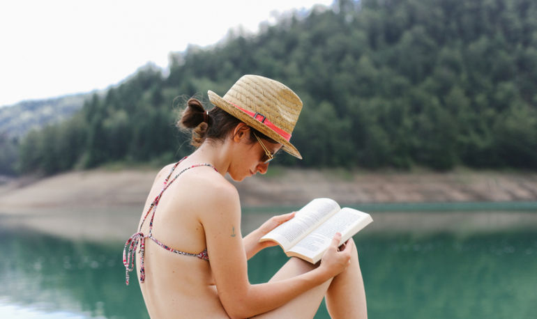 7 Life-Changing Books To Read This Summer (According To A Stanford Happiness Expert) Hero Image