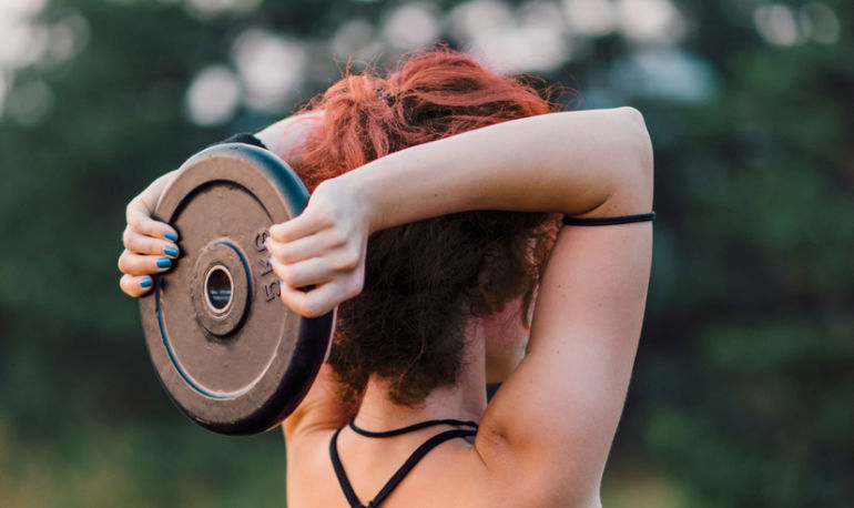 Research Says Lifting Heavy Weights Is More Effective For Muscle Gain — But Is It True? Here's What The Experts Say Hero Image