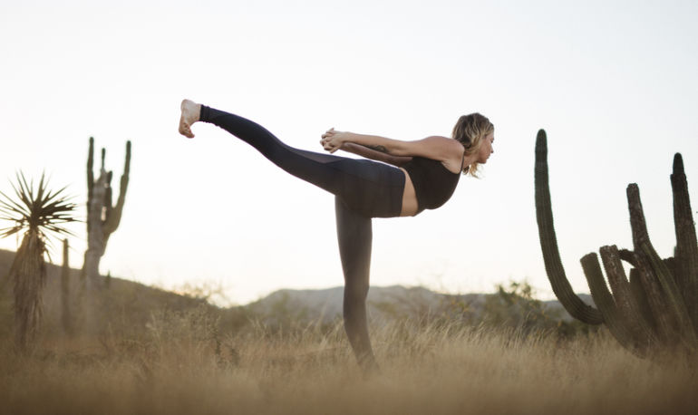 This Yoga Sequence Will Undo All The Damage You Do Staring At Your Phone Hero Image