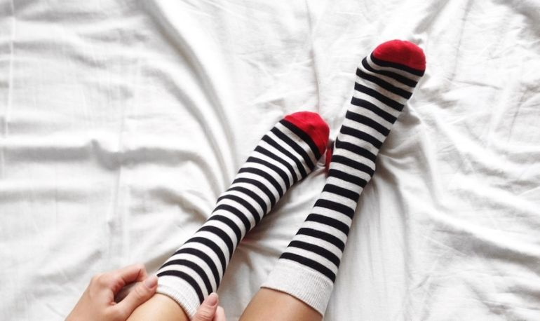 5 Cozy Pairs Of Socks You'll Want To Wear To Every Single Yoga Class Hero Image