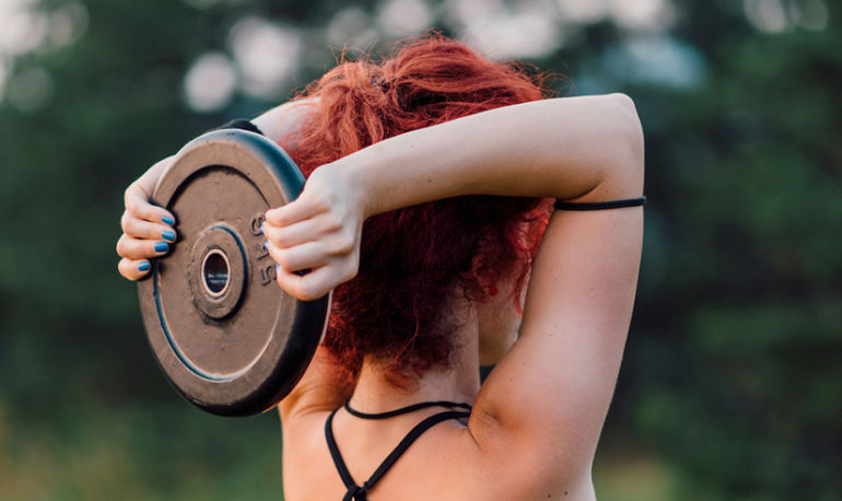 The Most Common Mistakes People Make While Lifting Weights + How To Fix Them Hero Image