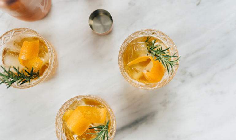 Healthy Ways To Navigate Your Holiday Party's Bar (11 Wellness Experts Weigh In) Hero Image