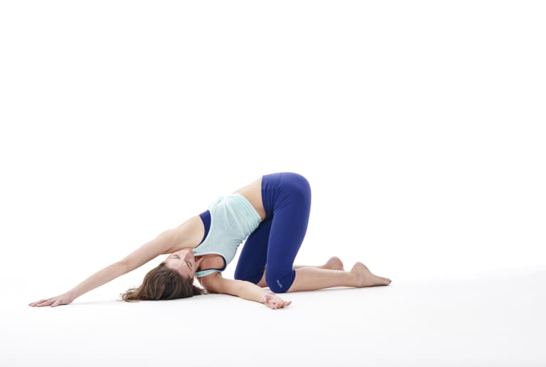 "tara stiles demonstrating child's pose with shoulder release or ""thread the needle"""