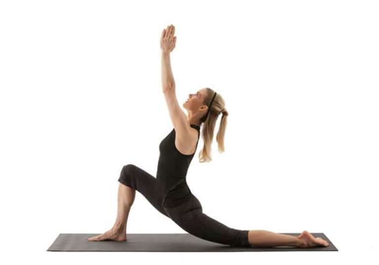 side view of woman demonstrating crescent lunge yoga pose
