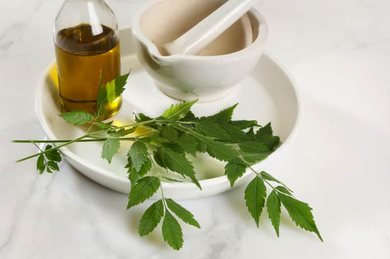 Neem Oil: Benefits For Skin & Hair + More About The Underrated Ayurvedic Beauty Oil