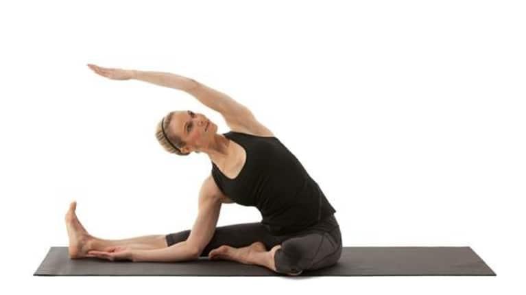 woman demonstrating revolved janu sirsasana yoga posa