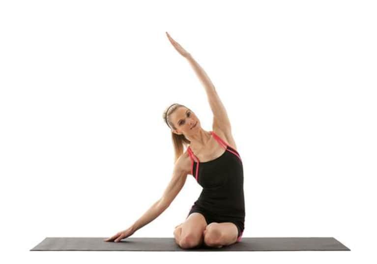 woman demonstrating mermaid pose yoga