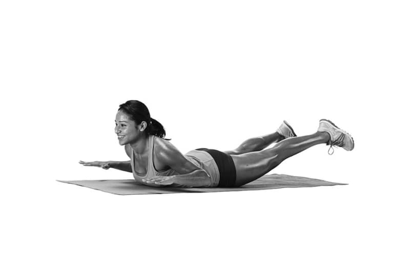 woman demonstrating glute exercise