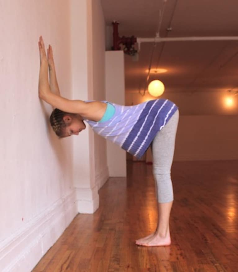shoulder opener at wall yoga pose