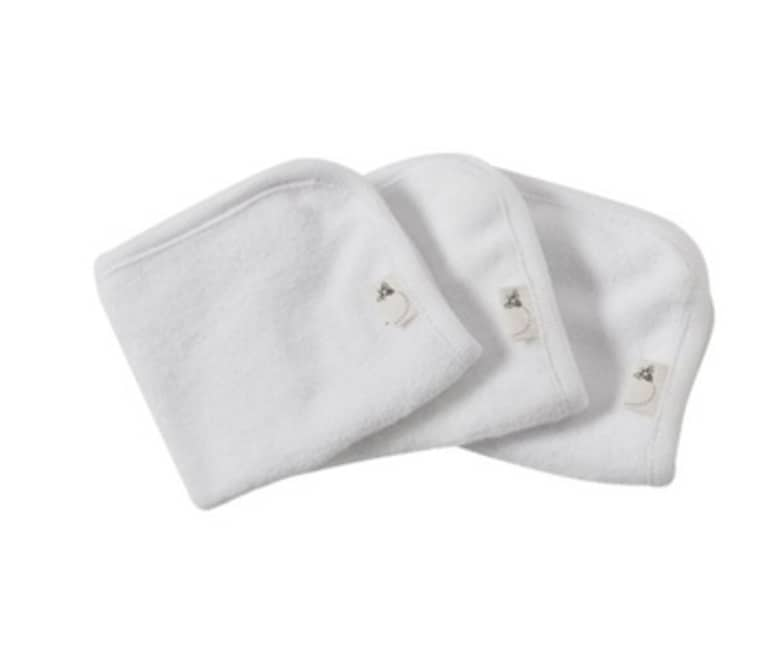 Three white Burt's Bees brand washcloths on white background