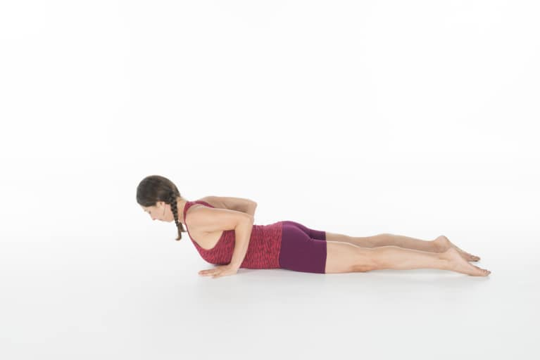 woman doing yoga cobra pose or bjujangasana