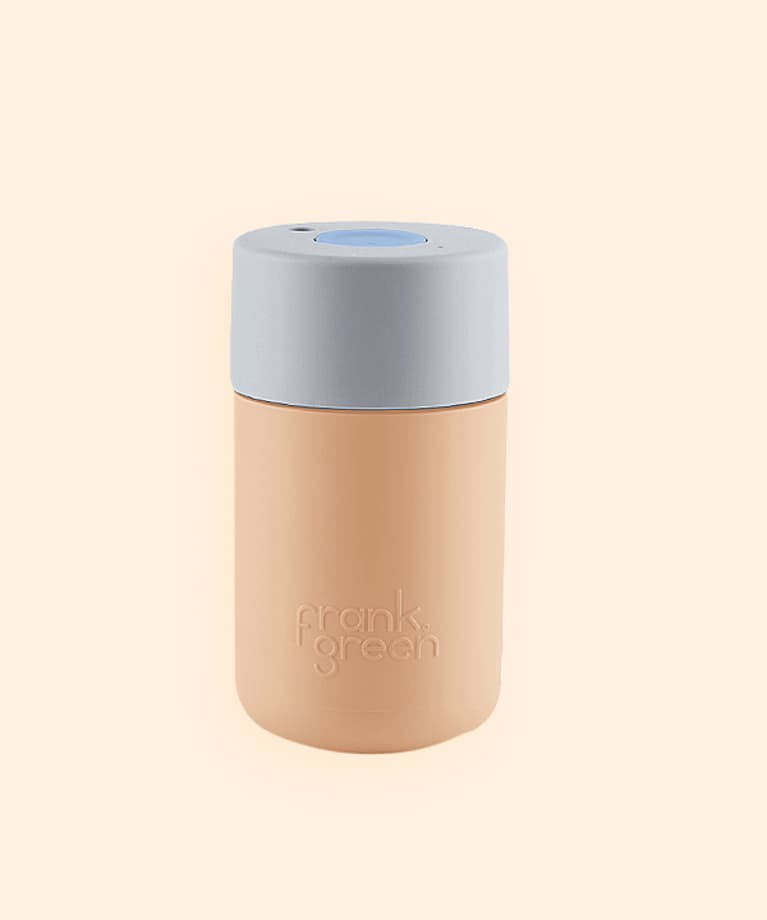 frank green brand peach colored thermos