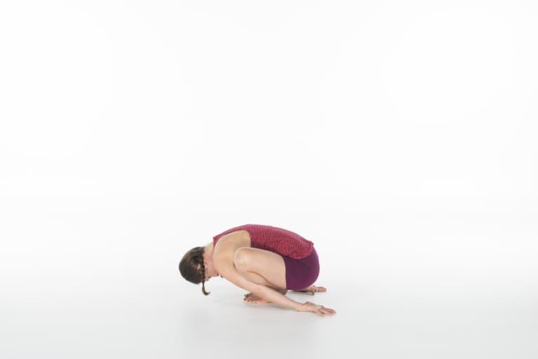 woman doing garland pose or malasana