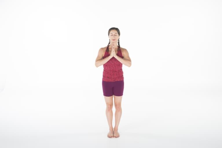 woman doing yoga mountain pose or tadasana
