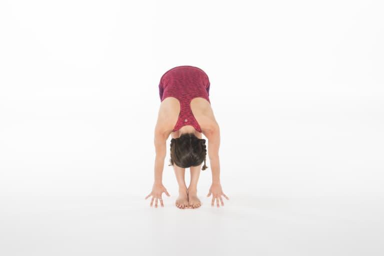 woman demonstrating standing forward fold yoga