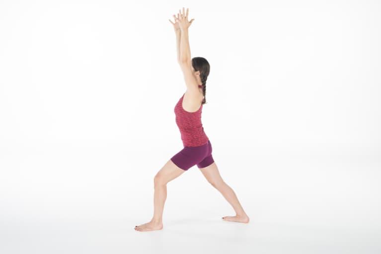 woman doing yoga warrior 1 or virabhadrasana