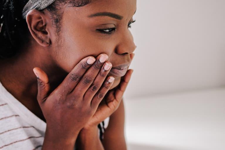 woman with beautiful skin applying a moisturizer
