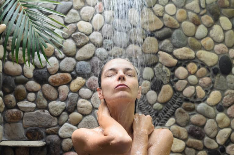 woman taking shower outdoors